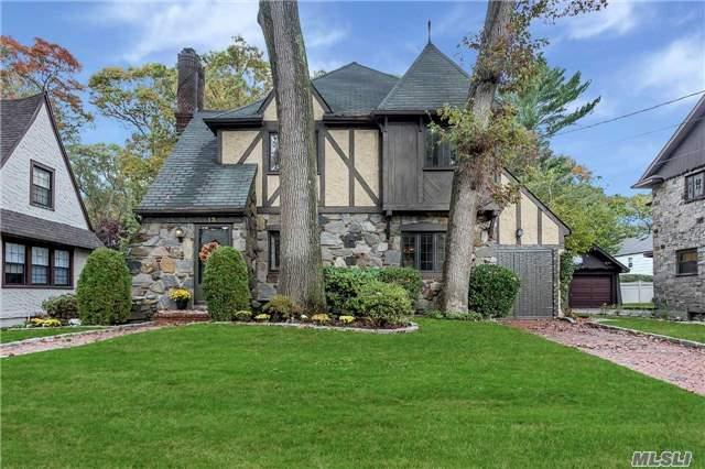 Charm Galore In This Move-In Condition 3 Bdrm 2 Bath Tudor/Colonial In Merrick Woods. Living Room W/Fireplace, Formal Dining Room, Eat-In Kitchen, Gas Cooking And Heat, Gleaming Hardwood Floors, Full Basement, Attached Garage. Beautiful Backyard. Won't Last!!