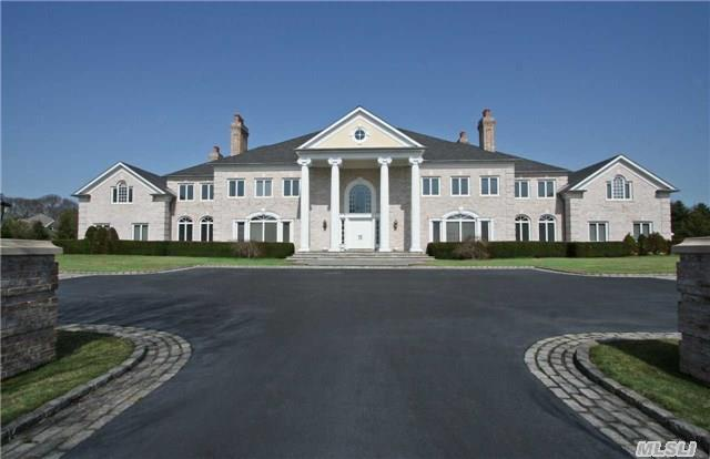 Enjoy Living In Complete Luxury, Serenity And Security In This Magnificent 15, 000 Square-Foot 1999 Manor House Sequestered On 5 Lush,  Gated Acres That Are Enfolded By Wrought Iron And Brick Estate Fencing.Located On A Beautiful Cul-De-Sac Country Road,  This Gorgeous Georgian Mansion Welcomes Guests Up A Tree-Lined Drive And Courtyard To Its Expansive Buff Brick Facade.