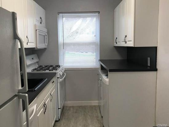 Freshly Painted & Updated! Beautiful White Kitchen With Grey Wood Floors Throughout To Dining Room, Updated Bathroom & New Rugs Close To All Shopping & Transportation To Nyc!