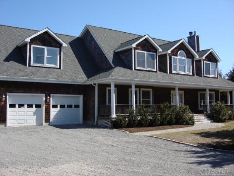 Just Minutes From The Village Of Westhampton And The Ocean Beaches. Lovely Home With Wrap Around Porch Set Back On A 1.38 Acre Flag Lot. Large Well Apponinted Kitchen Granite Counters. Two Sliding Doors Allows An Open View To The Pool And Rear Yard. Ready To Move In For This Season In The Hamptons!!  Peconic Tax Applies.