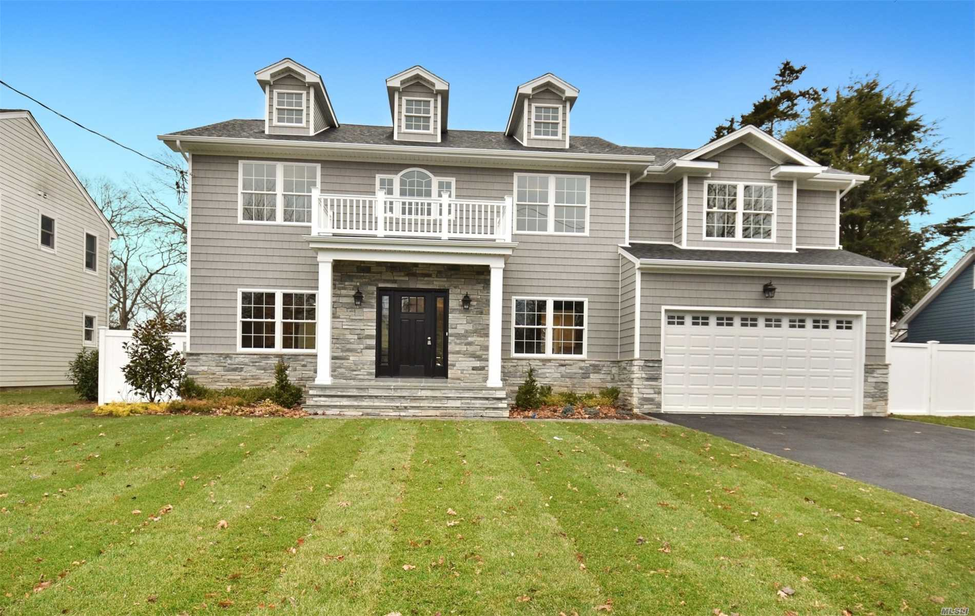 Spectacular Oversized, Park Like Property, North Syosset!! Stunning Sundrenched, 6 Bedroom, 4.5 Bath, Center Hall Colonial, North Syosset, Hw Floors, Gorgeous Gourmet Eik, Elaborate Trim Package, Stones Throw To Town, Rr, Village Elementary.