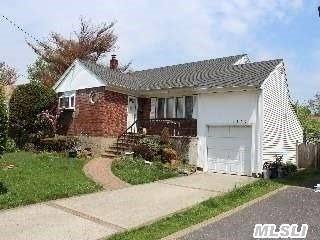 Beautiful 4 Bedroom 2 Bath Balcony Split At End Of Great Cul De Sac. Features Eat In Kitchen,  Livingroom W/Vaulted Ceiling & Formal Dining Room W/French Doors To Deck. Lower Level Large Family Room,  Brand New Bath,  New Heating System,  Hardwood Floors,  1 Car Attached Garage,  Large Yard & More.