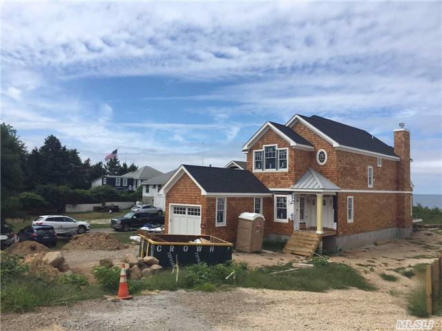 Waterfront New Construction! Sound Front Post Modern To Be Built. Gorgeous Walk Out Sandy Beach With No Bluff.Spacious New North Fork Cedar Shingled 3 + Bedroom W 3 Full Baths. Hardwood, Granite, Stainless Steel Appliances...Sunsets And Extraordinary Swimming. Don't Wait!