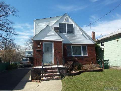 Just Reduced!Move-In-Condition! Large 5 Bedroom Expanded Cape With Many Possibilities. Beautiful Hardwood Floors. Ceramic Tile In Updated Eat-In-Kitchen And Hallway. Finished Basement. 2 Car Garage. Don't Let The Outside Fool You - House Is Very Spacious - 1970Sqft Of Living Space! Close To All!