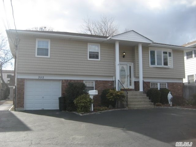 One Of A Kind Mint Hi Ranch On 56 X 180 Property.3 Car Detached Garage W/Heat & A/C Plus 1 Car Att. New Wood And Granite Open Kit On 2nd For W/Beaut Hw Floors, Huge Deck & Cac. Lovely And X-Lg Mint Apt On 1st Flr W/Patio Overlooking Lush Yard And 2 A/C Units. Mstr Suite On Each Flr. M/D W/Proper Permits- Buyer To Reapply.Great Layout, Space And Value. Fs Schools- Lo Taxes