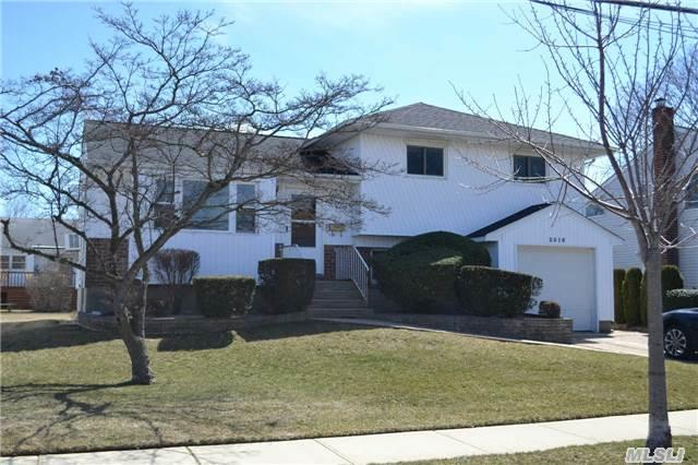 Great Opportunity To Own In South Bellmore At Such A Great Value! Newer Roof,  Heating System,  And Bathrooms,  Hardwood Floors Under Carpeting. Kitchen Needs Updating But At This Price You Can Update It To Your Liking.