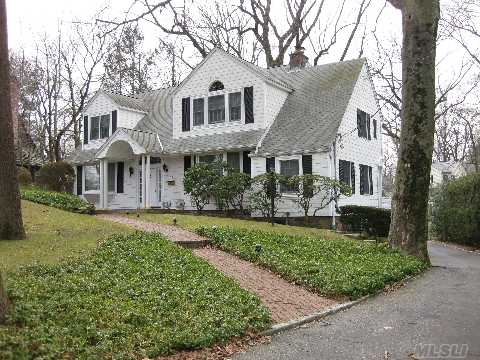 Beautiful County Colonial Expanded With Custom Renovations,2-Story Entry Foyer,Hugh Master Suite W/Cathedral Ceiling, Family Room W/Stone Wall Fireplace. Terrace Off Den, Deep Property. Walk To Munsey Park School, Bus,& Shops.   Buyer Must Verify All Information.
