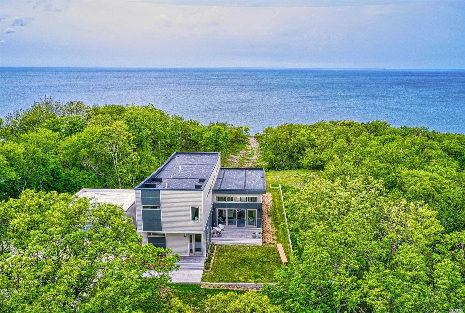 Enjoy Beautiful Sunsets From This Modern, Light-Filled Waterfront Home With 200 Feet Of Private Beach! This New Contemporary Home Sits High On 5 Acres Overlooking The Li Sound. It Is Energy Efficient And Offers An Open Floorplan With 4 Bedrooms, 3 Baths And 2.5 Car Garage. A Perfect Weekend Retreat To Enjoy The Relaxed Lifestyle Of The North Fork. Close To Vineyards.