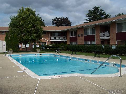 This 1 Bedroom Co-Op Situated In Farmingdale Village W/Poolside View Features Newly Refinished Hardwood Floors Throughout, Brand New Refrigerator And Stove, Freshly Painted, New Raised Panel Masonite Doors