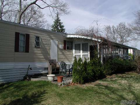 Very Well Kept 2 Bd/1Ba Mobile Home In 55+ Lakewood. Community Fees Are $484/Mo Which Incl Water, Garbage & Snow Removal, Cesspool, Clubhouse. New Furnace, Floors, & Washer. Beautiful Screened Sunroom.