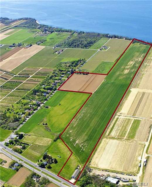 66+ Acres Of Vacant Farmland Property With 2 Acre Zoning And 559 Feet On Li Sound. There Is A 40 X 120 Barn With Concrete Floor And Electric. The Gorgeous Farm Views, Vineyard Views And Sound Views Create A Serene Environment Around The Property. With Access From Two Streets, This Property Is Perfect For Development. Public Water Now In The Street!