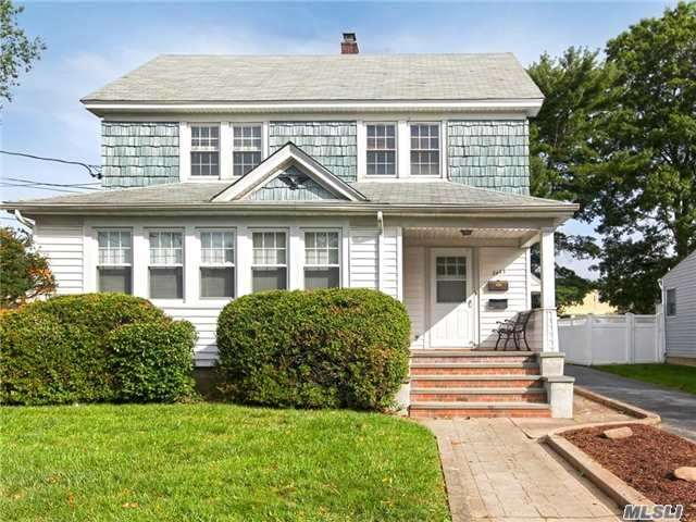 Great Potential In This Supersized Colonial. Can Be Used As Colossal Colonial Or 2Br Over 2 Br Mother/Daughter. H/W Flrs Throughout, 9 Ft Ceilings, Fresh Paint On 2nd Flr, New Windows, Updated Siding, Gas H/W Tank, 2-100 Amp Electric Meters, New Stoops, Unfin.Bsmt W/Ose, , Pvc, Long Driveway, Large 2.5 Car Gar W/Work Area, O/S Property, Mid Block, Close To All!Amazing Value!Wont Last!
