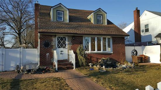 Eight Room Dormered Cape, Five Bedrooms With Two Full Baths. Updated Electric 200Amps. New Recessed Lighting On Both Floors, New Kitchen, New Gas Boiler, One Detached Garage. Crown Moldings, A Must See!!!!