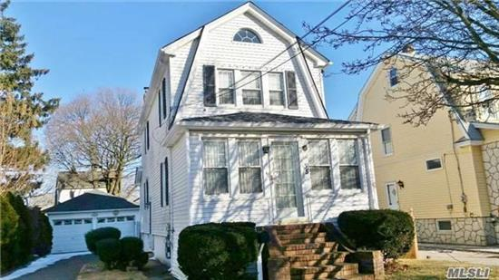 5 Minutes To Lirr And Supermarket. New Roof And Garage Roof, New Stove And Carpet. New Washer/Dryer, Porch Extension. Formal Dining Rm, Fireplace, Hardwood Floor. Plenty Of Windows And Closets. Finished Basement With Separate Entrance And Windows. Attic For Storage. Two-Car Garage With Remote Control. Nice Backyard. Make It Your Cozy Warm Home!