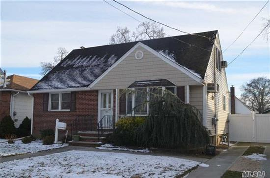 Super Low Taxes!!!! Not Effected By Sandy!!!This Charming Home Contains 4 Bedrooms, 2 Full Bathrooms, Wood Floors, Full Partially Finished Basement W/Ose, Newer Roof Siding And Windows, New Large Back Patio And Gas Heat!!! Close To Major Transportation And Shopping. Make This Your 2018 Dream A Reality.