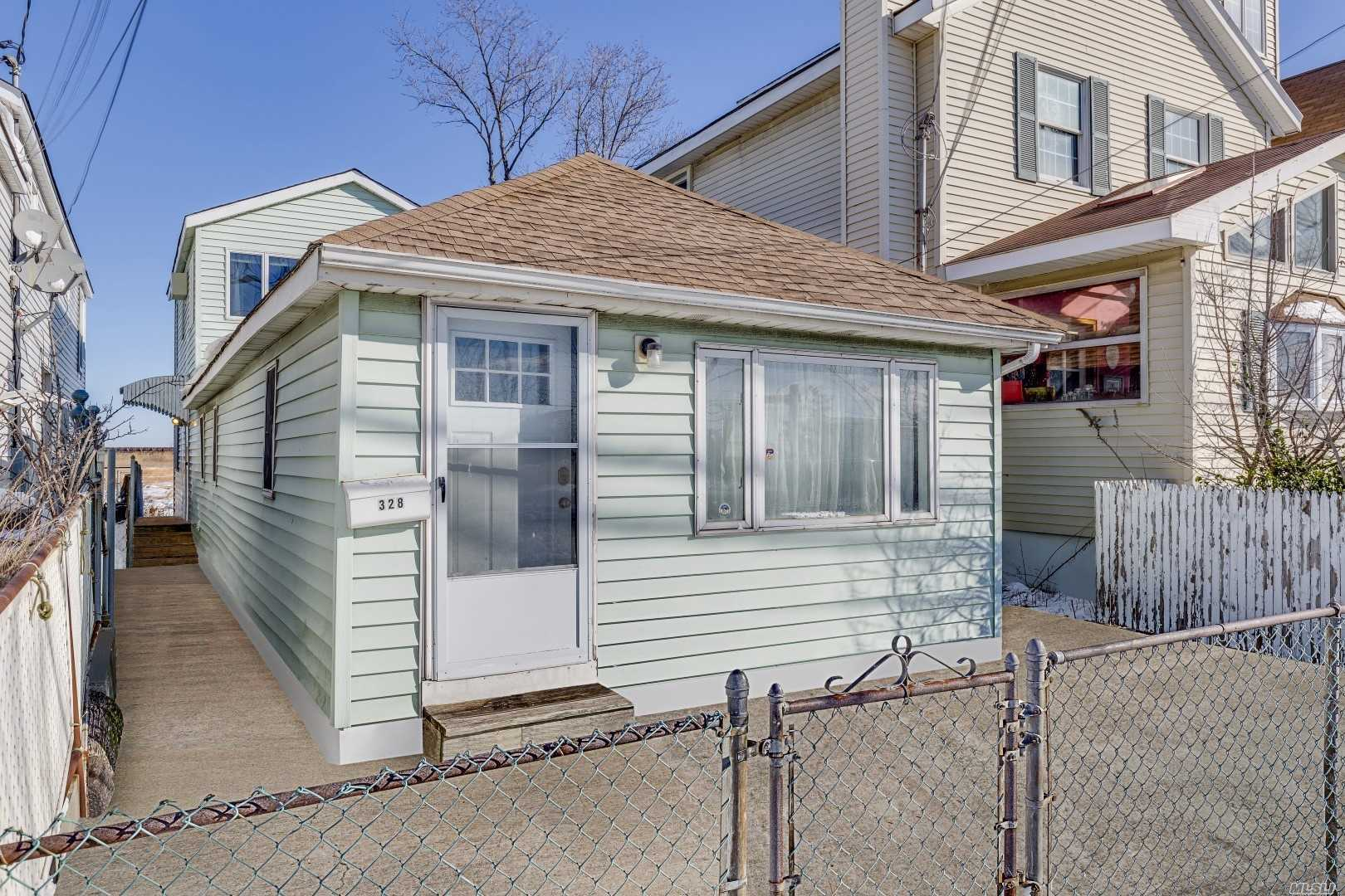 A Gem Located Next To The Heart Of Jamaica Bay Wildlife Refuge. No Worries Of Construction Blocking Your Backyard View. Renovated Front Apartment; Room For Mom, With Rear Apartment Updated.Separate Meters Minutes Away From Riis Beach. Restaraunts And Shopping Center Minutes Away.