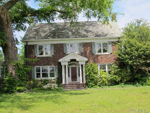 Elegant, Spacious Federal Style Brick Colonial With Fabulous Details On Spectacular 2.75 Acres - 4 Br, 2.5 Ba, Lr W/Fpl, Grand Formal Dr, Library W/Fpl, Lrg Heated Sunroom And More! Located Across From Beautiful Bay Front Homes - Minutes From The Beach.  Click On The Virtual Tour Of This Lovely Home.