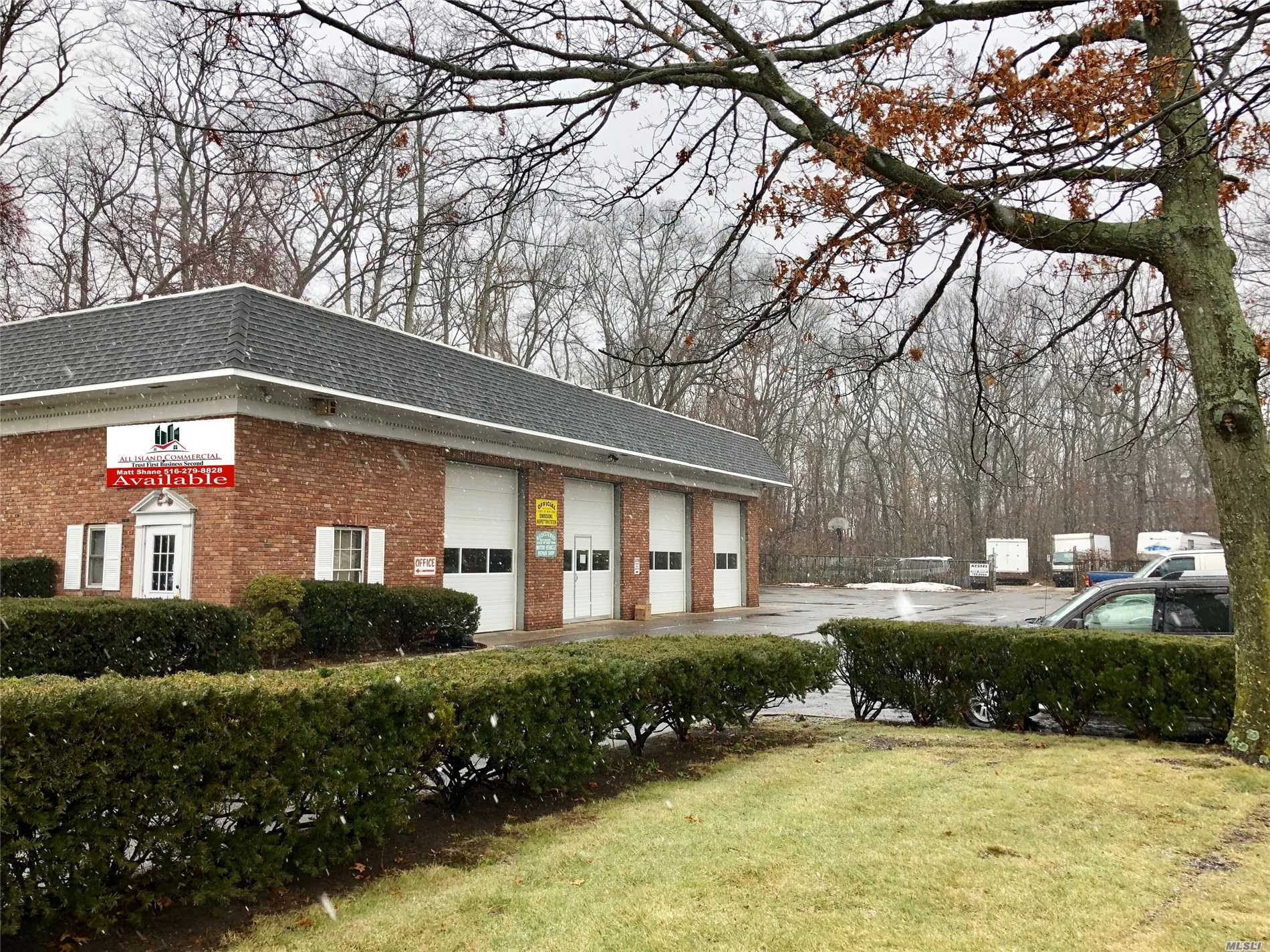 Calling All Mechanics, Auto Repair People & Investors. Beautiful 4-Bay Auto Repair Building With Large Parking Lot For Sale Off Of Busy Route 25A. Property Features 21' Ceilings, 3 Phase Electric, 36 Parking Spaces, (4) 12'X10' Garage Doors, (4) 15'X32' Bays, Waste Oil Heater +++