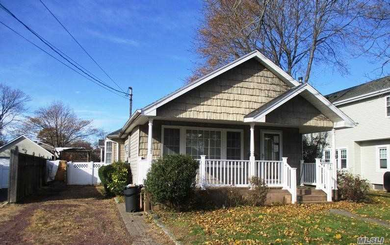 Vinyl Ranch With Rocking Chair Porch, Offers 3 Bedrooms, Dining Area, Living Room With Hardwood Floors And Fireplace, Kitchen With Plenty Of Cabinets, Laundry Area, Basement , Flat Rear Yard.