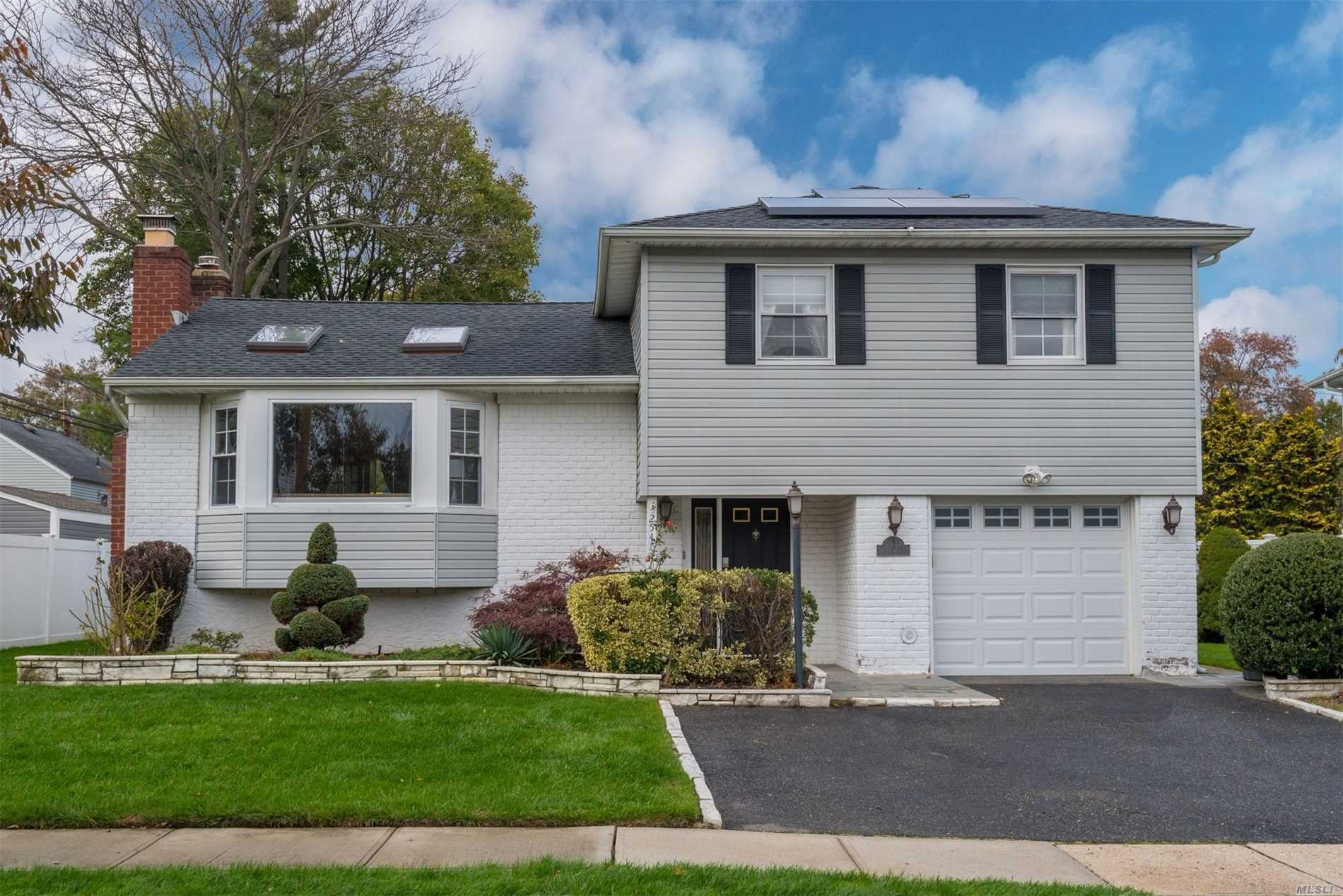 Beautiful, Updated/Exp Split -Perfect Move In Rdy Home W/3Skylights, Energy Eff: Solar Panels, Dishwasher, Mobile Controlled Thermos& Updated Windos & Roof. Eik W/Ss Appliances, Bfast Bar, Vented Hood For Cooking, Induction Stove Top, Microwave/Convection Oven. Part Fin Bsmnt, Exp. Fmly Rm& Open Concept Den/Dr. Vaulted Ceilings, Slider To Outdoor Deck/Patio In Large Yard.