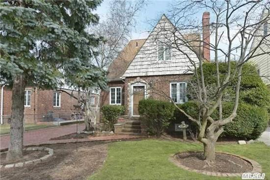 Brick - 3 Bedroom, 2 Bathroom Tudor/ Cape In School District 26. P.S. 18 And M.S. 172. Spacious Living Room With Cathedral Ceiling And Fireplace. Formal Dining-Room, Eat-In Kitchen, Bedroom And Full Bath On First Floor. Large Master Bedroom With Great Closet Space, 3rd Bedroom And Full Bath On Second Floor  Attic, Full Unfinished Basement. One Family Home.