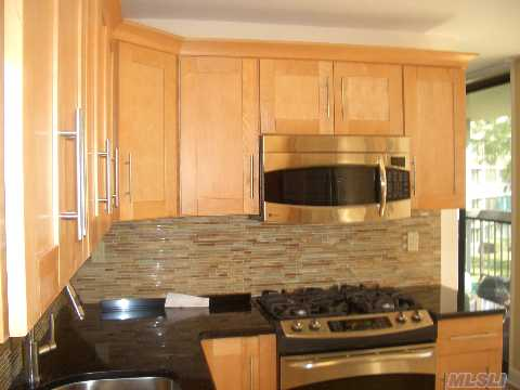 Owner Just Did $100K In Renovations By Top Designer; Ge Profile Stove+Oversized French Door Refrig;Granite Kitchen Stainless Steel Appls;New Hardwood Floors Thruout-A Must See To Believe. Deluxe 2 Bedroom With Separate Diningroom; Overlooks Quiet Garden View; Terrace; Conceiger,Doorman,Year Round Swim & Fitness Center; Tennis Club; Underground Stores And Restaurant.