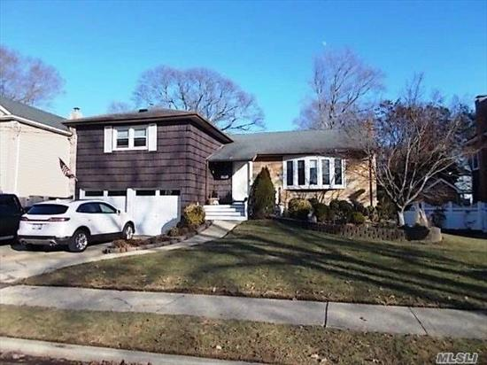 Spacious Split In Desirable Wantagh Woods School District #23. Large Living Room, Formal Dining Room, Eik With Granite Counters And Sliders Overlooking Beautifully Landscaped Yard. Central Air, 2 Updated Baths, New Pella Wndows, Gleaming Hardwood Floors Throughout. Taxes Don't Reflect Star Savings Of $1, 376.00.