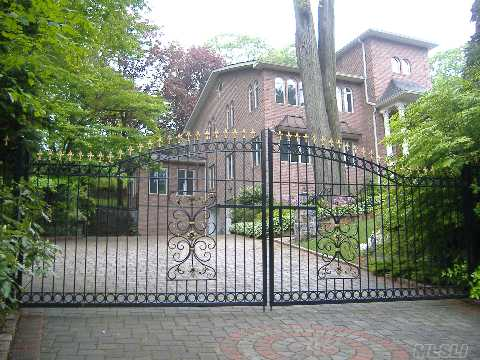 Private Gated Setting Custom Colonial Rebuilt On 2008 Over 1.42 Acres Of Unique Prop W.Majestic Trees.2 Story  Entry.Gourmet Eik. Spacious Living/Dining Area.6 Designer Marble Baths.French Doors.  Arched Windows .Balconies Overlooking A Gorgeous Swiming Pool.Olympic Size Tennis Ct!Best Commute To Nyc.Mins To Lirr.Incredible Value.Info Must Be Reverified By The Buyer