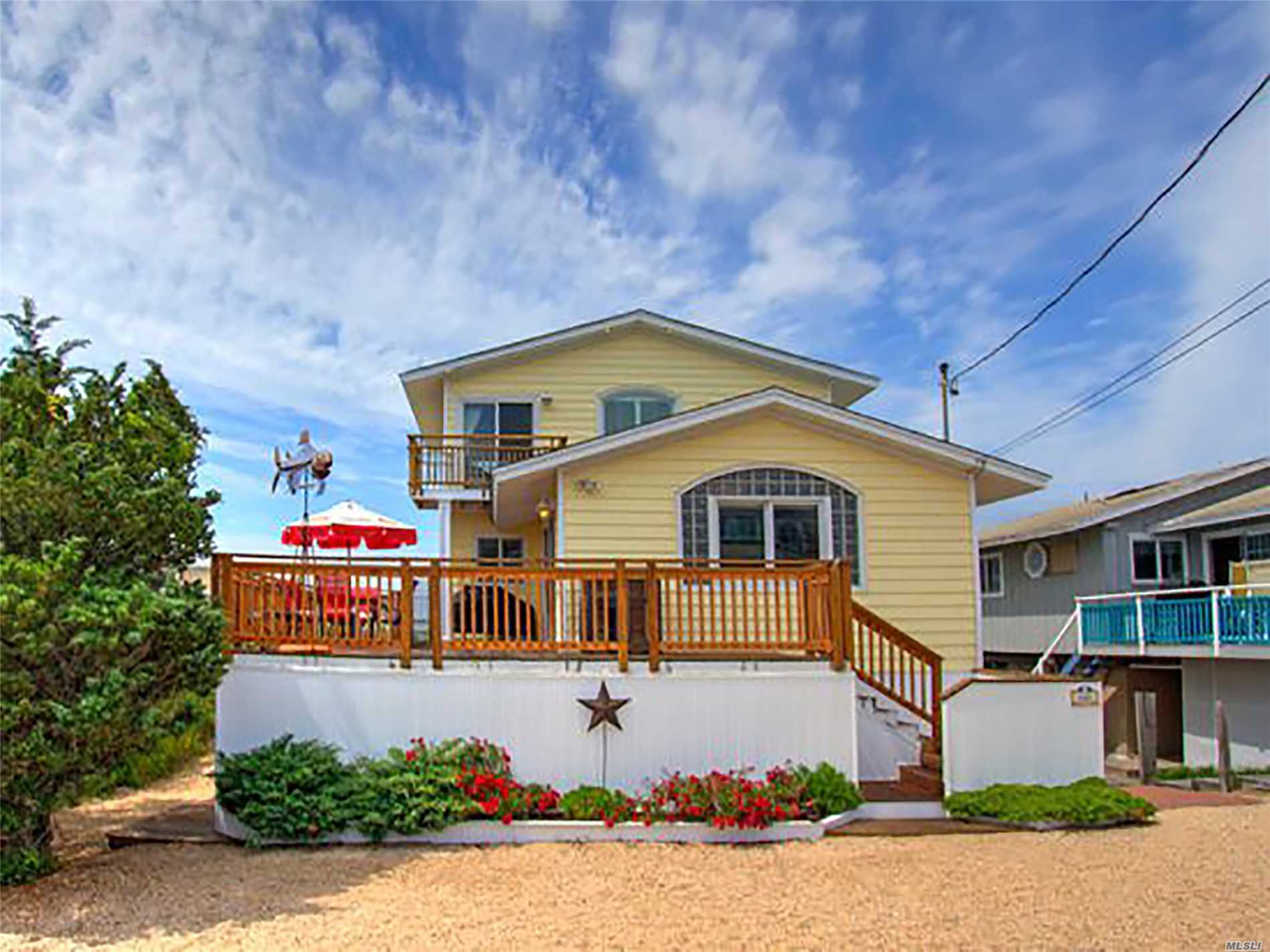 This Quaint 3 Bedroom Is Just Steps From The Ocean. It Features A First-Floor Open Floor Plan With 2 Bedrooms And A Bathroom. Move Upstairs To The Master En-Suite Bedroom With A Private Balcony That Has Great Ocean Views. Enjoy A Bbq On The Deck That Overlooks Dune Road At The End Of A Long Beach Day.