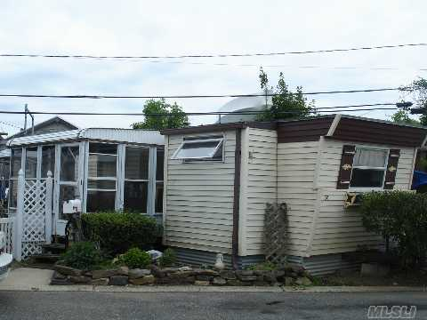 Well Kept One Br Mobile Home Situated On Waterfront Prop. W/Dock Space Available, Fishing And Crabbing Right Off The Dock.Large Encl. Porch, Outside Deck, Two Sheds, One With Electric. Centrally Located To Train, Public Trans.Shop, Restaurants. Great Place To Live Full Time Or Part Time For All You Snow Birds! $740.00 Maint. Before Star. This Park Has It All!