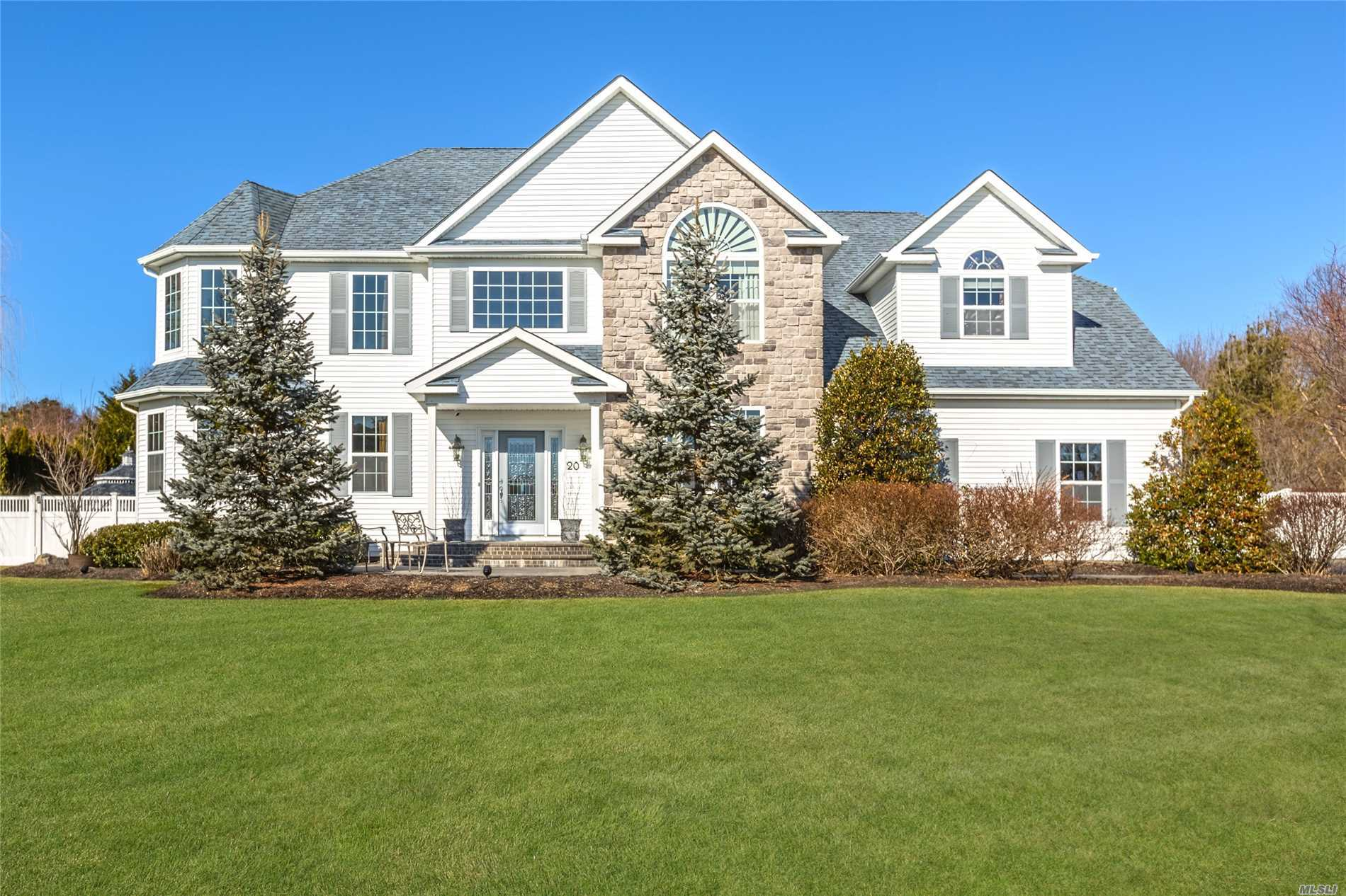 Come See This Stunning Post Modern Located In The Prestigious Country Manors Development. This Home Has It All! Updates Galore And A Backyard To Die For! Yard Has Expansive, Lush Landscaping, A Heated, In-Ground Pool, And A Sanded Volleyball Court!