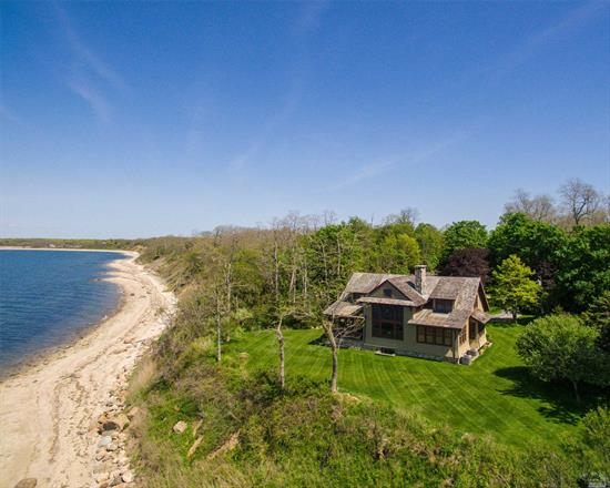 A 6600-Foot Drive Down A Narrow Lane Leads Through Woods And Vineyards To This Handsome Shingle-Style Home, Set On An Extraordinarily-Private 2.5-Acre Waterfront Estate With 340 Feet Of Low-Bluff Frontage On Long Island Sound. Completed In 2009, The Residence Is Amenity-Rich And Exquisitely Crafted. Come Home And Live Graciously.