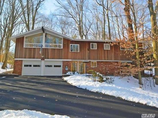 Beautiful Swedish Contemporary Hi Ranch In A Wooded Vermont -Like Setting Located On 1 Acre In The Exclusive Village Of Northport. Priv Beach Rts. Along W Access To Village & Town Bchs. Award Winning Schools, Golf, Boating/Sailing, Theatre, Restaurant & Much More! This 4 Bdrm 2 Bth Home W/Vltd Clg In Open Concept Lvrm, /Drm W Updated Galley Kitchen! Tax Grieved Est $2000!