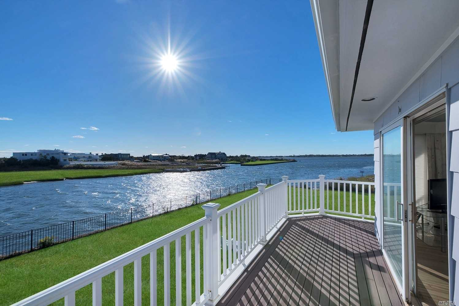 The Quintessential Quogue Location. Welcome To The Point Of Quogo Neck Lane. With Over 600 Feet Of Bulkhead And A Protected Slip, If You Are A Boat Lover You Just Found Heaven. Heated Gunite Pool And 1.8 Acres To Enjoy, Nothing Compares To Waking Up On The Second Floor, Opening Your Eyes And Seeing The Water From Every Window. Stroll Onto Your Balcony And Get Lost In The Salt Air Breezes. Move Right In Or Build Your Dream House.