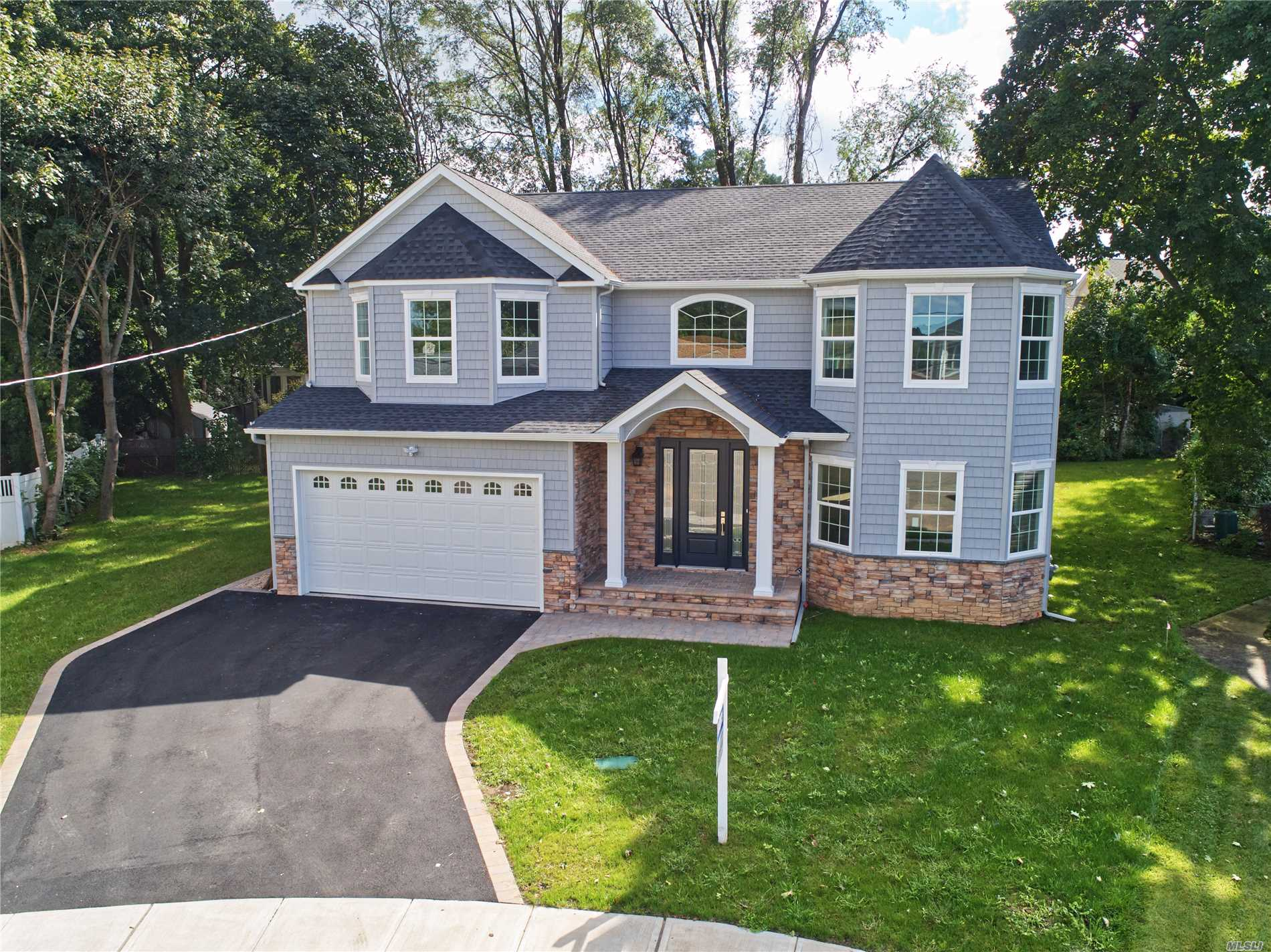 Nestled In The Heart Of North Syosset And Tucked Away In The End Of A Private Cul-De-Sac. This Magnificent New Construction Home Is Conveniently Located A Short Distance From The Lirr. The Is Now Complete And Officially Open To The Public, A Full Photography Package Will Be Uploaded Within The Next Few Days