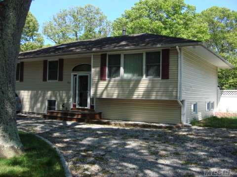4 Bedroom, 2.5 Bath Hi Ranch In Fair Condition... Large Rooms, Hardwood Floors, Updated Windows, Siding, And Roof, Possible Mother/Daughter With Proper Permits!
