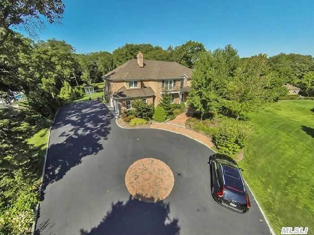 Beautiful,  Custom,  6 Bedroom,  4.55 Bath Home.  Two Story Entry Foyer,  Crown Molding,  And Radiant Heat In Kitchen And Baths. Spacious Rooms. Hardwood Floors. Fireplace. Spectacular Private Property. New Large Trex Deck Off Kitchen And Den. Great For Entertaining. Plenty Of Room For Pool And Tennis Court.  Award Winning Syosset School District!