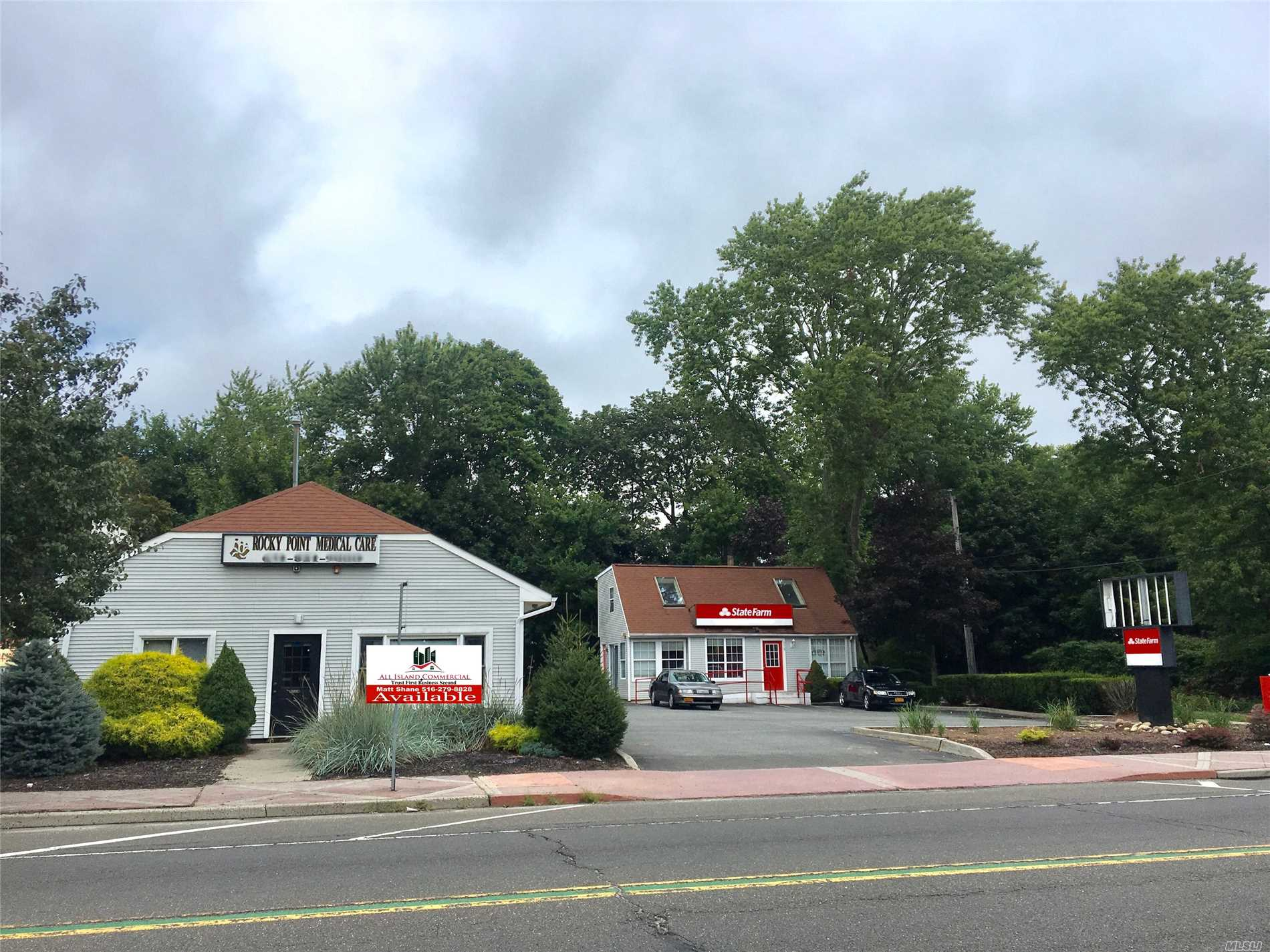 Located On Busy Route 25A In The Heart Of Town. Two Beautiful Free Standing Commercial Bldgs Located On A 20, 000 Sf Corner Property. Full 2000 Sq Ft Basement With Separate Entrance. State Farm Has A Five Year Lease With Annual Increases. J-6 Zoning Allows For Variety Of Uses
