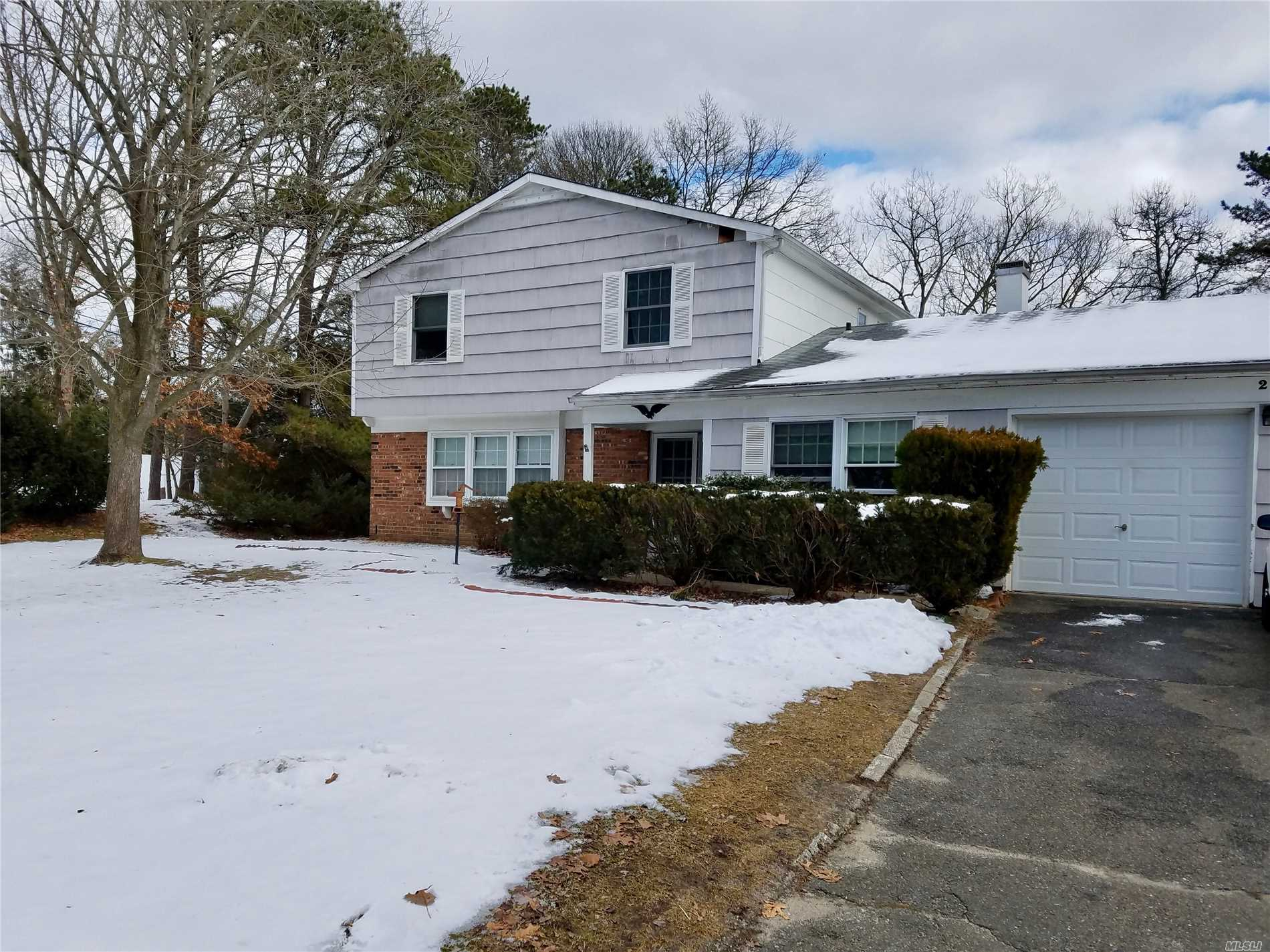 Spacious Colonial Style Home Located In The Tanglewood Forest Development Of Coram. Offering Three Bedrooms 2.5 Baths, Living Room, Den, Formal Dining Room Plus An Eat In Kitchen. Master Bedroom With Full Bath, Situated On A Half Acre Corner Property With A Two Car Attached Garage. Call For A Private Viewing To See What Great Potential This Home Has To Offer.