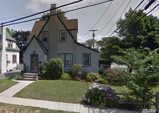 Lovely Tudor Colonial Home Boasts Old World Style. This 3 Bedroom Charmer Features An Entry Foyer, Fieldstone Fireplace In Lr With An Adjacent Office Space, Updated Baths, Formal Dining Room, 4 Zone Igs, Brick Patio, Roof & Hot Water Heater Approx 4 Years Young. Ideal Location For Proximity To Lirr & Shopping.
