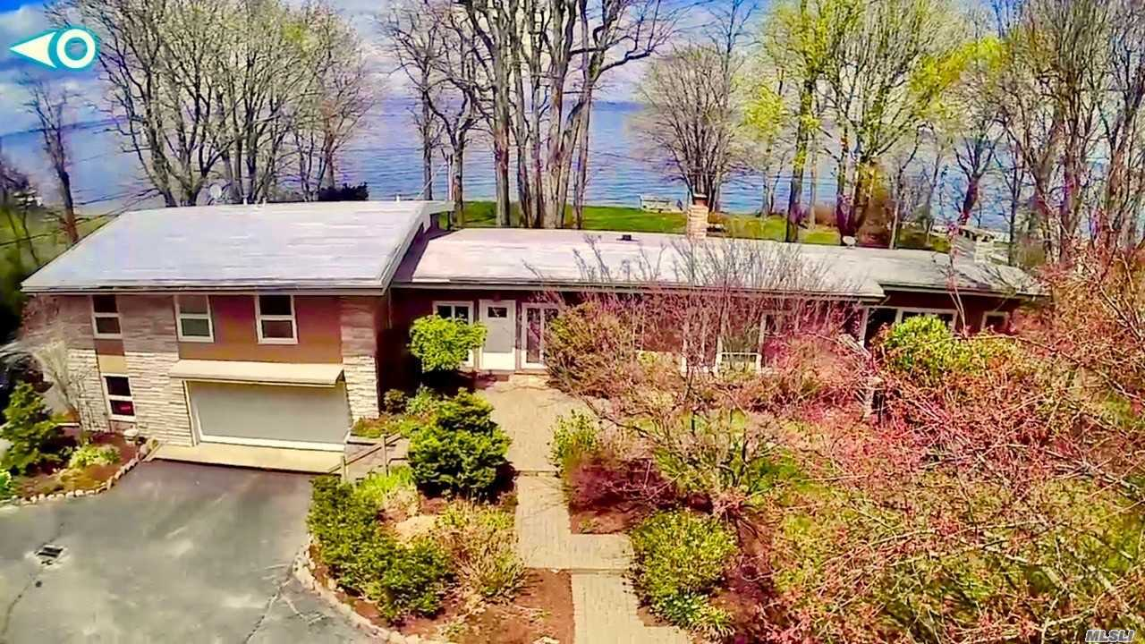 Unique 2.99 Acre (2 Lots) Sound Front Sprawling Split Ranch With Amazing Views Featuring 200 Feet Of Bulk Headed Beach Overlooking The Long Island Sound. On A Clear Day Enjoy Views All The Way To Norwalk, Connecticut. Updated Siltstone Eat In Kitchen, Den W/ Wood Burning Stove, Huge Open Layout, Family Room With Fireplace, Master Suite, Huge Private Yard With Pvt Beach Access, A 200 Foot Private Driveway Adds To The Privacy Of This Property, Meticulously Maintained With Records Of All Upgrades