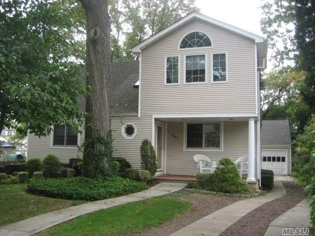 Unique 5 Bedroom 3.5 Bath Colonial On 55X231 Parklike Property On Dead End Street. Open Lr And Dr With Sliders To Deck. Master Br With Fbth, Finished Basement. Near Worship, Shops & Lirr.