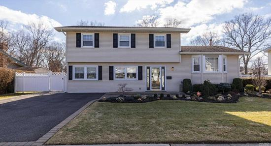 Truly Gorgeous Home Renovated In 2015!!Half Hollow S.D.Open Floor Plan, Eat In Kitchen With Island/Granite Counters/Stainless Steel/Wine Fridge, Living Rm, Family Rm, Laundry/Office, Dining Rm, Master W/Bath, 3 Add'l Bedrms, Family Bth, All Hardwood Floors, Newer:Windows, Electric, Roof.Finished Basement W/Ose, Fenced Yard, Back Town Property!Solar Panels, Magnificent Move In Home!