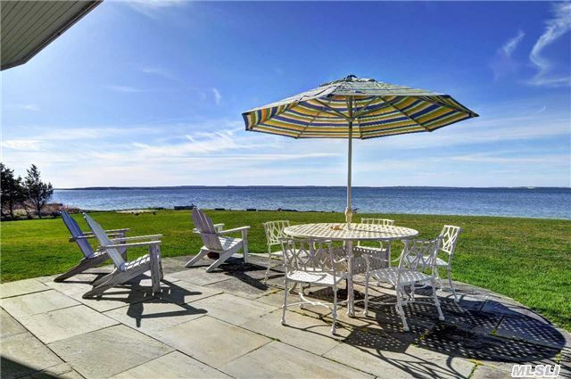 Life On Little Peconic Bay...Wake Up To 100' Of Waterfront, All Waterside Brs Have Sun Deck. Thoughtfully Designed Home Has 5 Br, 3 Ba, Eik, Great Rm W/ Fp, Sun Rm, 2 Laundry Rm, Full Bsmt & 2 Car Gar. Enjoy Southwest Exposure W/ Sun All Day & Evening Sunsets. Perfect For Entertaining Guests W/ Grace & Style. Close To Award Winning Wineries & Restaurants.