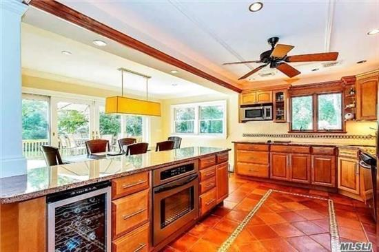 This Immaculate Multi Split-Level Home Is An Entertainer's Dream! Open Floor Plan, Kitchen W/ Custom Cabinets, Island W/ Bev Fridge, Granite Countertops & Ss Apps, Hw Flr, Lr/Dr, Incredible Bathroom W/ Radiant Flooring, Jacuzzi Tub & Steam Shower, Wine Lounge (4th Bdrm!!! , Fin Bsmnt W/ Ose, 2 Car Garage, Glass Sliders Lead To Deck W/ Outdoor Kitchen, Lg Fenced In Yard!