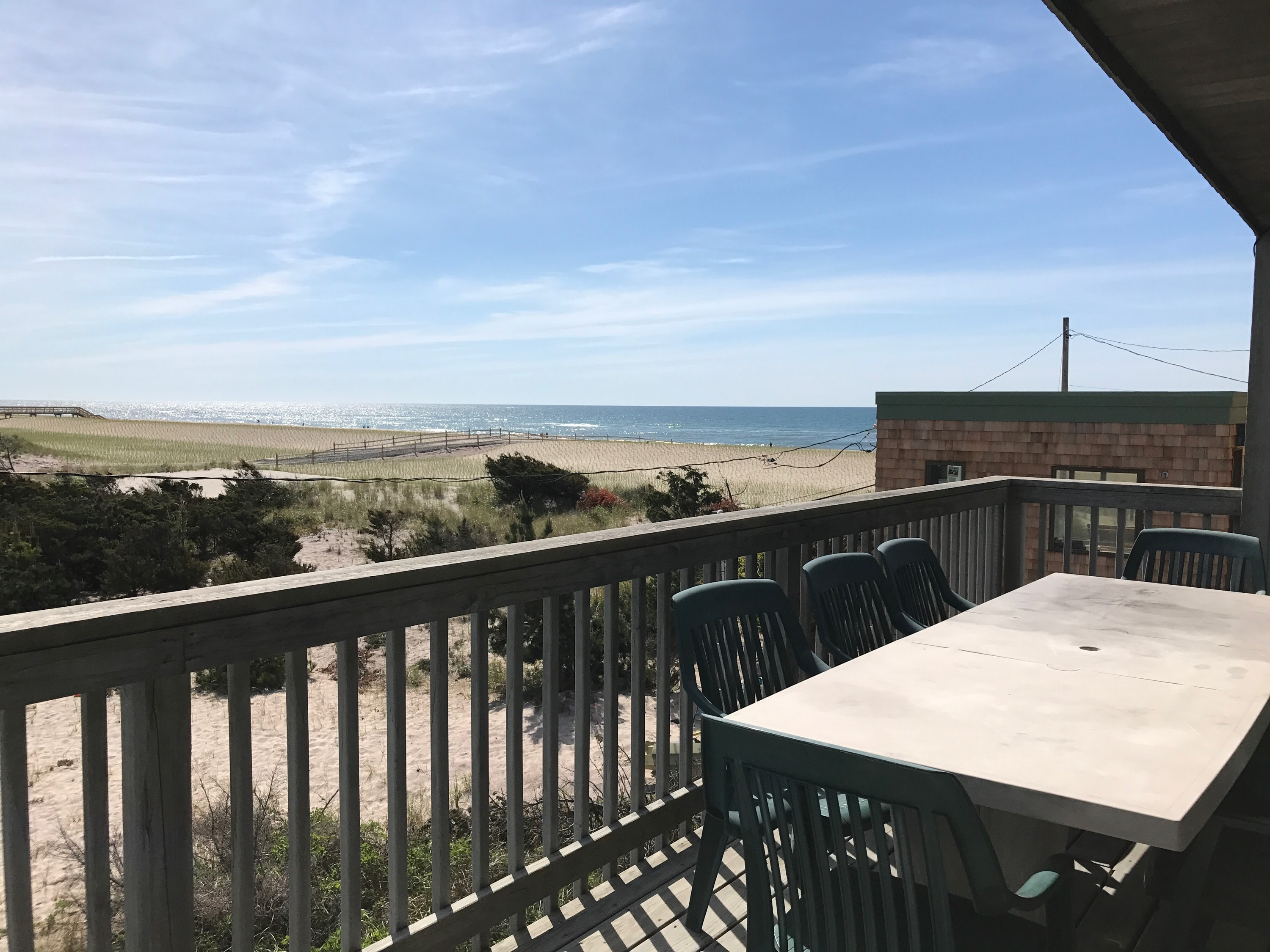 Spend your vacation enjoying sweeping views of the bay and the ocean.  Steps to the beach, this home has a large open great room to die for.  With 8 bedrooms, this house has room for everyone.  Hot tub.  Multiple decks.  Views galore! Boat slip included. 2018 Pre/Post Season weeks available for $5,000.