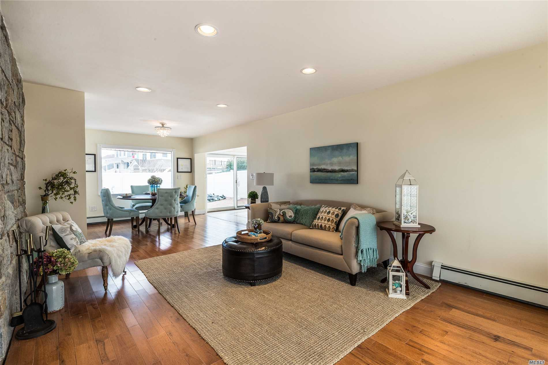 Brand New Granite Kitchen With Stainless Appliances. All New Baths, Heating And Electric. Open Floor Plan With Windows Overlooking The Vacation Style Backyard. Built In Pool And Private Dock With New Bulkhead On The Thixton Canal. A Short Boat Ride Out To The Hewlett Bay. 1 Mile To Lirr.