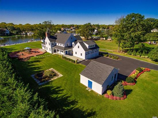 Gorgeous 5000 Sq Ft Waterfront Colonial In O-Co'nee Estates. Totally Rebuilt In 2012 Situated On 1.6 Acres W/110' Of Bulkhead W/Deep Water Docking. Located On Lawrence Creek W/Beautiful Views. No Expense Spared. 4Br, 3.5 Bath, Beautiful Eik W/Gas Fpl, Flr W/Wood Burning Fpl, Master Suite W/Fpl & Fbth, Maids Qtrs, Full Bsmt, 3 Car Att Garage.