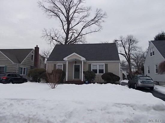 Beautiful Expanded Cape With Great Curb Appeal. Finished Basement, 1.5 Car Garage, Great Schools, Close To Lirr.