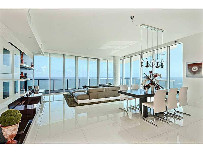 South East Corner Condo With East + West Exposures, Private Elevator/Foyer, Leading To Unobstructed Flow-Through Views Of The Ocean, Intracoastal And City Skyline. This Contemporary Designer-Appointed Lower Penthouse Features Top Of The Line Finishes- Whi Te Glass Flooring, Custom Built-In Entertainment Center And Closets, Electric Window Treatments, Italian Light Fixtures. Furniture Package Available Separately. Impeccable Condition. Easy To Show!